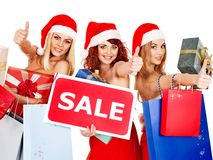 Girl in Santa hat holding Christmas gift box. Stock Photos