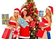 Girl in Santa hat holding Christmas gift box Royalty Free Stock Photos