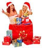 Girl in Santa hat holding Christmas gift box Royalty Free Stock Photo