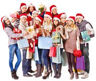 Girl in Santa hat holding Christmas gift box. Stock Images