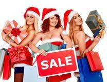 Girl in Santa hat holding Christmas gift box. stock image