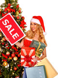 Girl in Santa hat holding Christmas gift box Stock Images