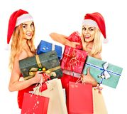 Girl in Santa hat holding Christmas gift box. Stock Photo
