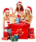 Girl in Santa hat holding Christmas gift box. Stock Photos