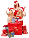 Girl in Santa hat holding Christmas gift box. Royalty Free Stock Photos