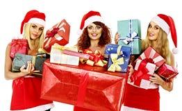 Girl in Santa hat holding Christmas gift box. Stock Photography
