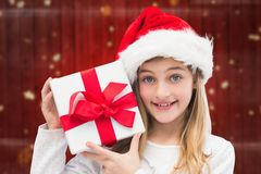 Girl in santa hat holding christmas gifts Royalty Free Stock Photography