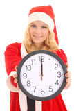 Girl with santa hat holding clock Royalty Free Stock Image