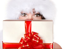 Girl in santa hat holding gift box. Isolated Royalty Free Stock Photo