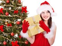 Girl in santa hat holding  gift box. Christmas girl in santa hat holding  gift box.. Isolated Royalty Free Stock Photos