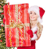 Girl in santa hat holding gift box. Stock Photo