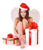 Girl in santa hat holding gift box. Stock Photos