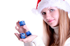 Girl in santa hat holding  gifts Stock Photography