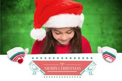 Girl in santa hat holding placard Stock Images