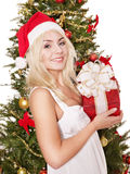 Girl in santa hat holding red gift box. Stock Image