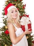 Girl in santa hat holding red gift box. Stock Image