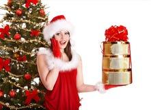 Girl in santa hat holding stack  gift box. Stock Photo