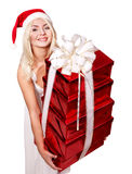 Girl in santa hat holding stack gift box. Stock Photo