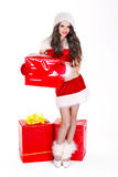 Girl in santa hat holding stack gift box Royalty Free Stock Images