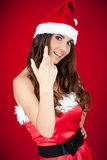 Girl with santa hat inviting Royalty Free Stock Photo