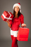 Girl in Santa Hat isolated on gray background Royalty Free Stock Photos