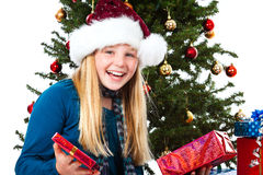 Girl with santa hat laughing Stock Image