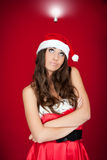 Girl with santa hat looking for solution Royalty Free Stock Image