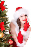 Girl in santa hat making silence gesture. Royalty Free Stock Images