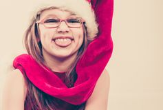Girl in santa hat making silly face royalty free stock photos