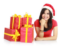 Girl in santa hat with many gifts Royalty Free Stock Photo