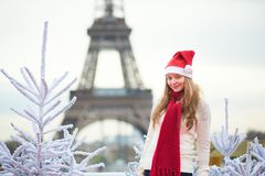 Girl in Santa hat near the Eiffel tower Stock Photography