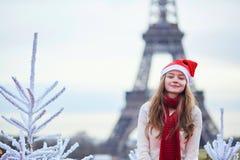 Girl in Santa hat near the Eiffel tower Stock Photography