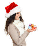 Girl in santa hat portrait with handful of little gift boxes posing on white background, christmas holiday concept, happy and emot Stock Photo