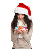 Girl in santa hat portrait with handful of little gift boxes posing on white background, christmas holiday concept, happy and emot Royalty Free Stock Photos
