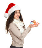 Girl in santa hat portrait with handful of little gift boxes posing on white background, christmas holiday concept, happy and emot Stock Images