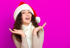 Girl in santa hat portrait on pink color background, christmas holiday concept, happy and emotions Stock Photos