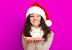 Girl in santa hat portrait on pink color background, christmas holiday concept, happy and emotions Royalty Free Stock Images