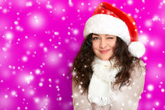Girl in santa hat portrait on pink color background, christmas holiday concept, happy and emotions Stock Photography