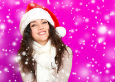 Girl in santa hat portrait on pink color background, christmas holiday concept, happy and emotions Royalty Free Stock Photos