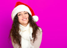 Girl in santa hat portrait on pink color background, christmas holiday concept, happy and emotions Stock Photo