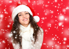 Girl in santa hat portrait on red color background, christmas holiday concept, happy and emotions Royalty Free Stock Image