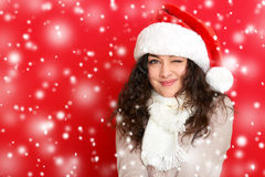 Girl in santa hat portrait on red color background, christmas holiday concept, happy and emotions Stock Photos