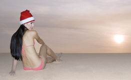 Girl in Santa hat posing at sunset Royalty Free Stock Photography