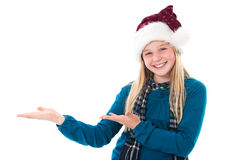 Girl with santa hat presenting copyspace Stock Photo