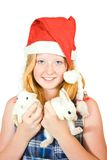 Girl in santa hat with  rabbits Royalty Free Stock Images