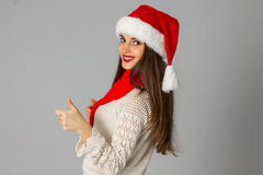 Girl in santa hat and red scarf Royalty Free Stock Images