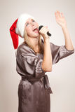 Girl in Santa hat Stock Photos