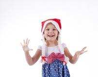 Girl in santa hat. Stock Photo