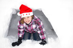 Girl with santa hat in the snow Stock Photography
