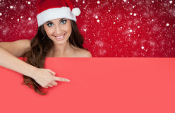Girl with santa hat on snow showing on billboard Stock Photo
